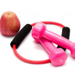 Dumbbells with rubber and apples — Stock Photo