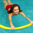 Young woman is swimming with noodle — Stock Photo #7982974