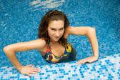 Beautiful girl in swimming pool — Stock Photo