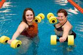 Mum with a daughter in aqua aerobics — Stock Photo