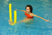 The woman does exercise in water — Stock Photo