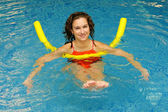 The woman does exercise in water — Foto Stock