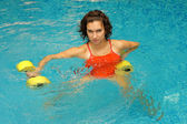 Woman in water with dumbbels — Stock Photo