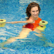 Woman in water with dumbbells — Foto Stock