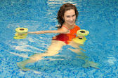 Woman in water with dumbbells — Stock Photo