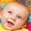 Happy baby lies on a back — Stock Photo #8328229