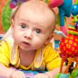 Baby plays in baby gym — Stock Photo #8328232
