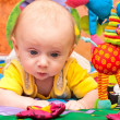 Baby plays in baby gym — Stock Photo #8328239