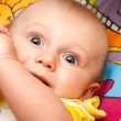 Happy baby lies on a back — Stock Photo #8328241