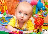 Baby plays in development gym — Stock Photo