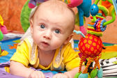 Baby plays in baby gym — Stock Photo