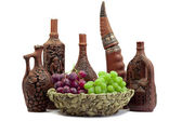 Wine jars-bottles of clay with wine and grapes in front — Stock Photo
