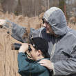 Stock Photo: Father and son watching birds at lake
