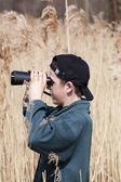 Boy watching the birds at the lake — Stock Photo