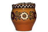 Clay pot with coins — Stock Photo
