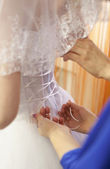 Pre-ceremony bride dressing — Stock Photo