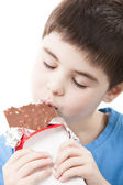 Boy with chocolate in the hands — Stock Photo