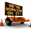 We're Working On It! - Construction Sign — Stock Photo #7966530