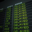 Airport Flight Information Board, Delayed — Stock Photo