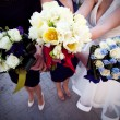 Bride and bridesmaids holding their bouquets — Stock Photo #10415772