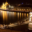 Hungarian parliament and chain bridge at night, Budapest - Stock Photo