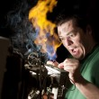 Stock Photo: Funny electrician on fire
