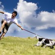 Man playing with his dog on sunny summer day — Stock Photo #8828799