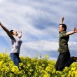 Royalty-Free Stock Photo: Young couple having fun in summer rapeseed field