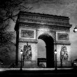 Triumph arch from Paris at night on vintage paper — Stock Photo