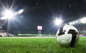 Soccer ball in stadium at night — Stock Photo