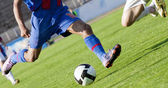 Soccer player running after the ball — Stock Photo