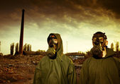 Two man wearing gas masks after nuclear disaster — Stock Photo