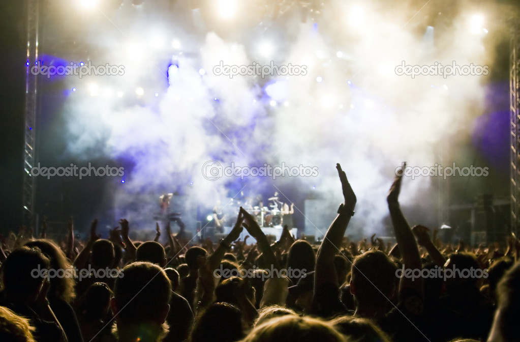 Crowds cheering concert