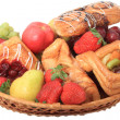 Basket with fruits and pastries. — Stock Photo