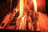 Fire inside the fireplace — Stock Photo