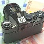 Photocamera lying on the euros — Stock Photo