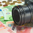 Photocamera lying on the euros — Stock Photo #8547580