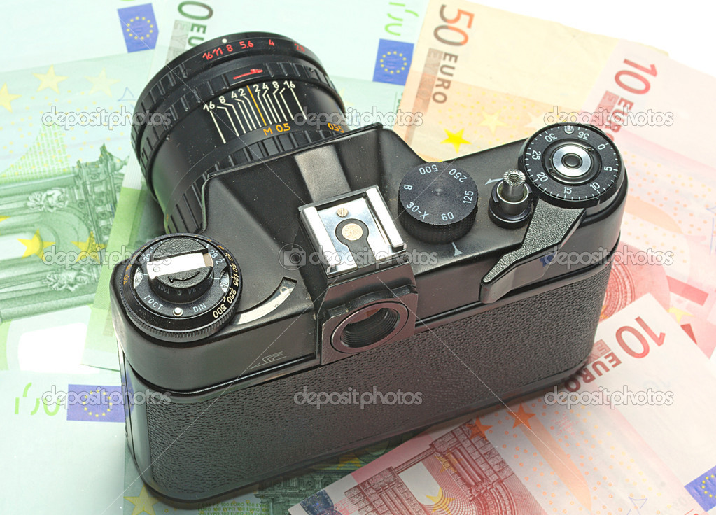 Photocamera lying on the euros for background — Stock Photo #8547572