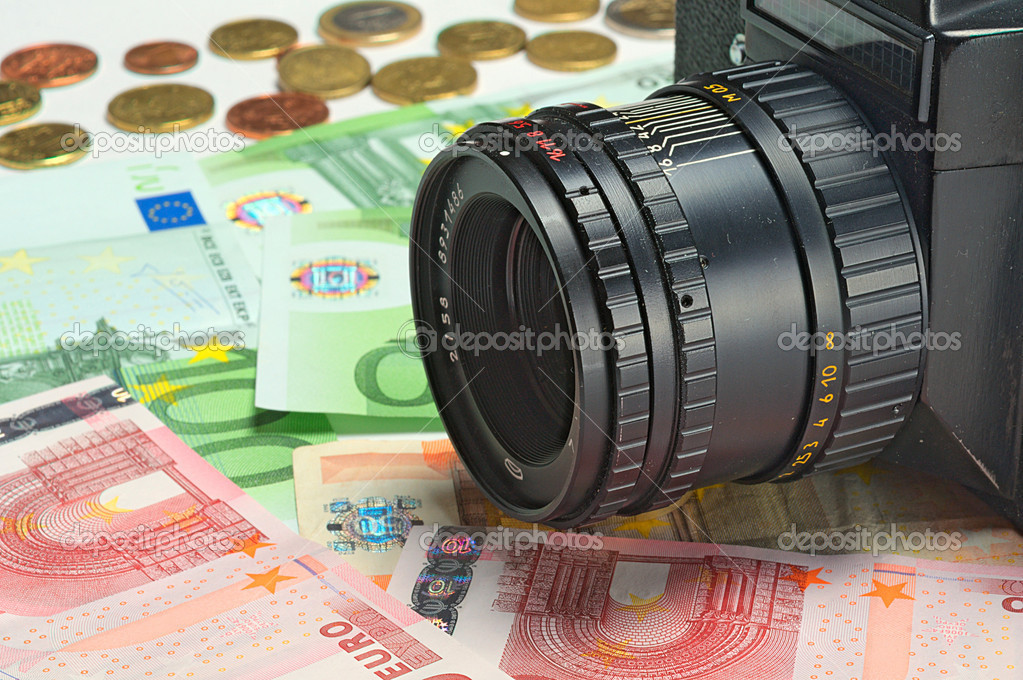 Photocamera lying on the euros for background — Stock Photo #8547580