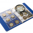 Album for coins and magnifying glass — Stock Photo