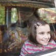 Girl and car window — Stock Photo