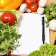 Note book among the vegetables — Stock Photo