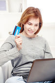 Happy girl doing on line shopping with credit card — Stock Photo