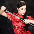 Woman and katana sword — Stock Photo