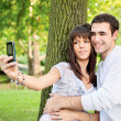 Young couple taking picture of themselves — Stock Photo
