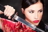 Woman and katana sword — Stock Photo