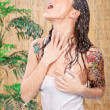 Woman with tattoos under shower — Stock Photo #10669910