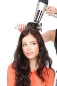 Hairdresser is drain a long black hair — Stock Photo