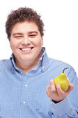 Chubby man holding pear — Stock Photo