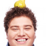 Chubby boy and pear — Stock Photo